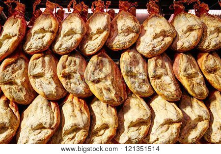 Jamon serrano ham from Spain whole in a row Iberico