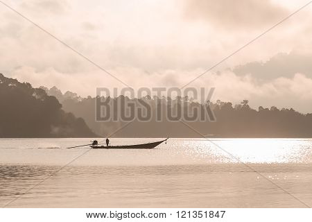 Silhouetted Sailing Boat