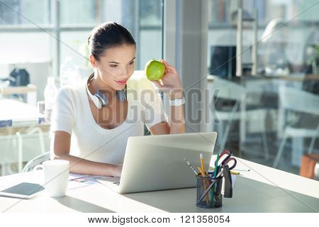 Beautiful young businesswoman is working in office