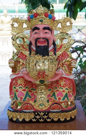 The fat chinese god smile and happy