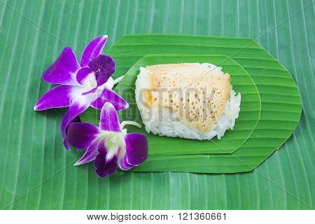 Sticky Rice With Steamed Custard With Orchid Flower On Banana Leaves, Sweet Sticky Rice, Thai Sweet
