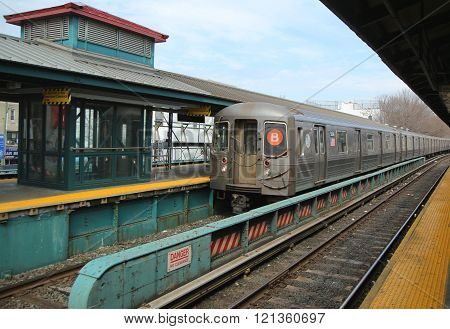 NYC Subway B Train arriving at Kings Highway Station in Brooklyn