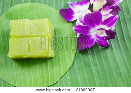 Kind Of Thai Sweetmeat, Multi Layer Sweet Cake (kanom Chan) On Banana Leaf With Orchid Flower