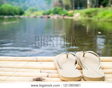 A Pair Of Sandal Near The Canal