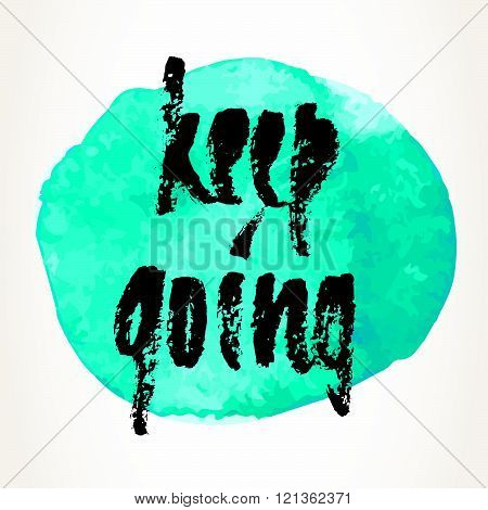 Hand written motivational saying. Modern brush pen lettering over turquoise watercolor painted circle. Keep going hand typography.