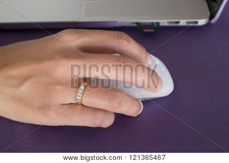 Woman hand clicking wireless mouse, stock photo