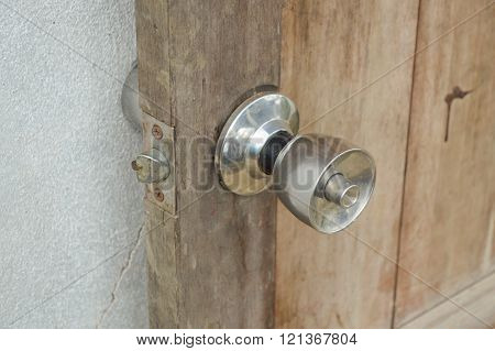 close up door knob on wood door