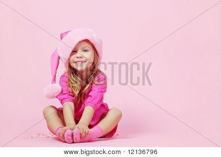 Portrait of lovely little Santa helper child