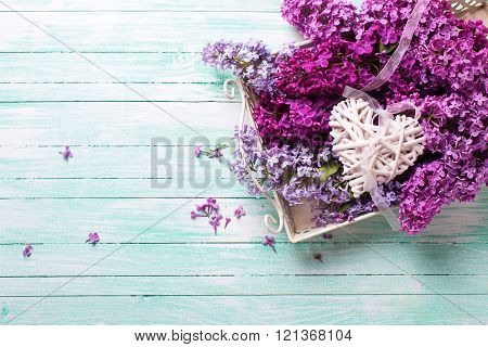 Fresh Splendid Lilac Flowers On Tray  And  White Decorative Heart On Turquoise Painted Wooden Planks