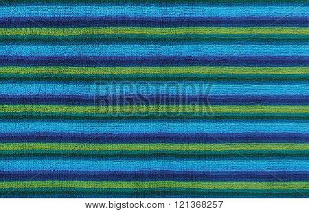Blue striped beach towel useful as a background pattern
