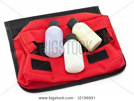 Three Travel Size Bottles On A Toiletries Bag