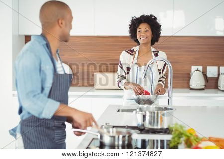 Happy couple preparing meal in the kitchen