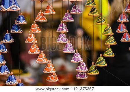 Ceramic hanging bells in the handicraft mart Kaziukas, Vilnius, Lithuania