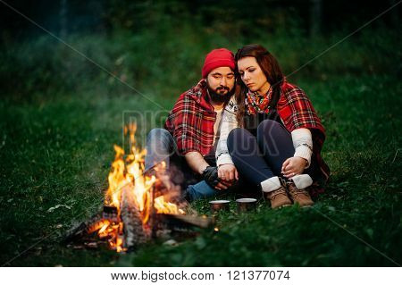 Lovers Around The Campfire At Night