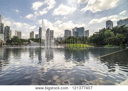 KUALA LUMPUR, MALAYSIA - JANUARY 30, 2016 : Garden view with water feature at Kuala Lumpur Convention Centre park.