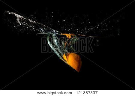 Tropical Fruit Orange Fell Into The Water