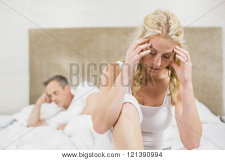 Upset couple sulking each other in their room
