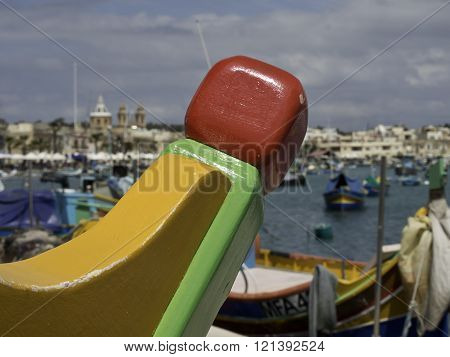 colourfull fishing boats in the Harbour of malta