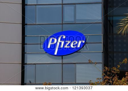 Tel Aviv, Israel - March 7, 2016: Pfizer logo on a building. Pfizer develops and produces medicines and vaccines for a wide range of medical disciplines