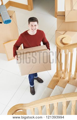 Portrait Of Young Man Moving Into New Home