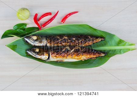 Japanese food style, Saba fish grilled the plate on wooden background.
