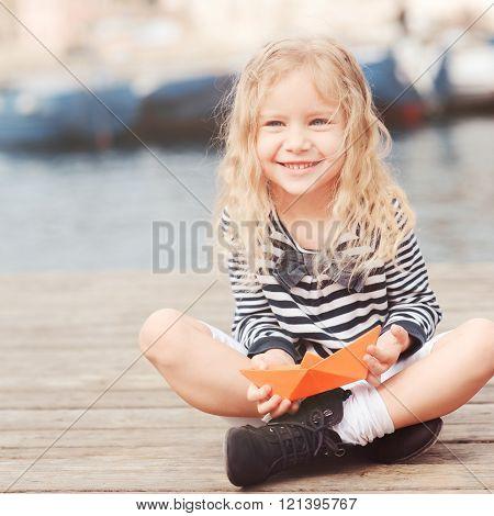 Happy kid girl outdoors