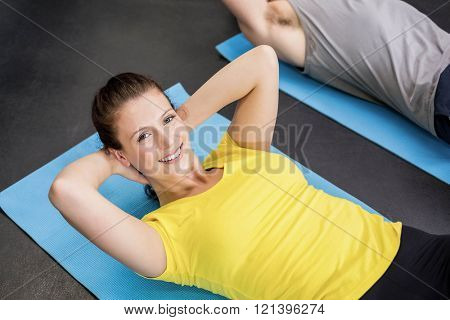 Pretty woman working her abs in gym