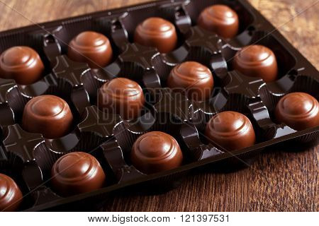Chocolate Candies In A Plastic Box