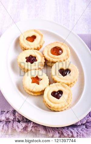 Jam Filling Linzer Cookies On Plate
