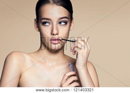 Nice girl with lip gloss