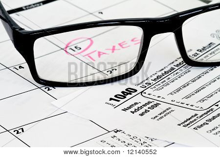 1040 form calendar and reading glasses