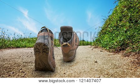 two hiking boots run outdoors concept image