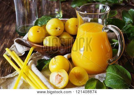 Yellow Plum Juice In A Glass Jug