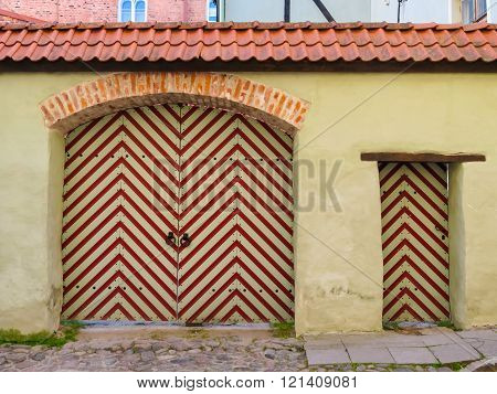 Old Striped Gate In The Old Town