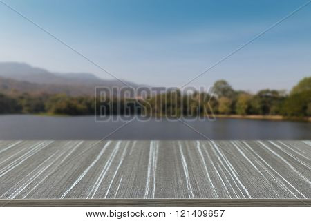 Empty Wooden Table With Mountain And The Pond In The Park Blur Background