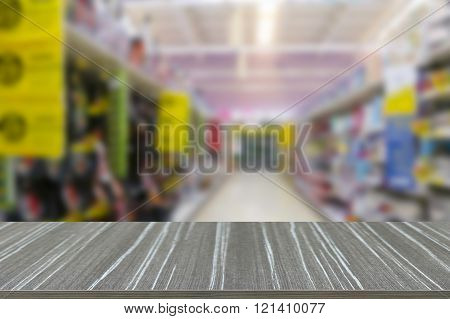 Empty Wooden Table With Goods On The Shelf In Supermarket Blur Background