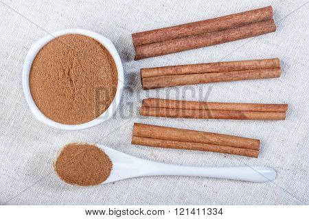Powdered cinnamon in a ceramic bowl, cinnamon, close-up, ceramic spoon, photo.