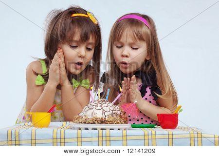 Little girls eating birthday cake