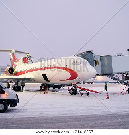 Moscow, Russia, February, 09,2015: plane on airport Domodedovo connected to gate sleeve in winter