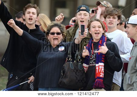 Saint Louis, MO, USA - March 11, 2016: Donald Trump supporters cheer outside the Peabody Opera House in Downtown Saint Louis