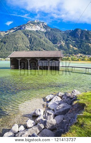 Old boathouse at lake Achensee in Austria