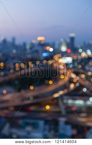 Night bokeh lights highway interchanged and city down town background