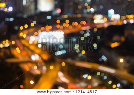 Areal view freeway intersection night, abstract blurred bokeh