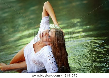 Beautiful young girl resting in water