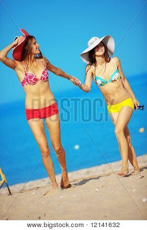 Beautiful girls having fun at beach