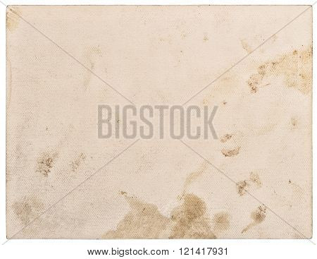 Textured paper cardboard closeup with stains and edges isolated on white background