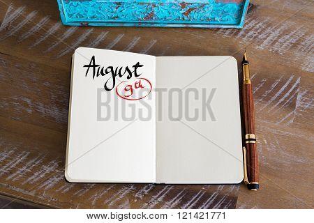 August 9 Calendar Day Handwritten On Notebook