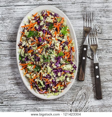 Fresh Vegetable Salad With Red Cabbage, Carrots, Sweet Peppers, Herbs And Seeds. Healthy Vegetarian