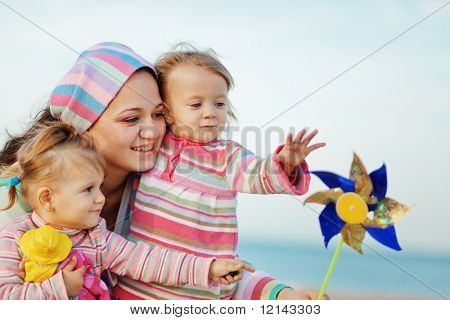 Happy family resting at beach