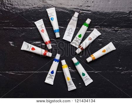 A Set Of Acrylic Colors On The Floor